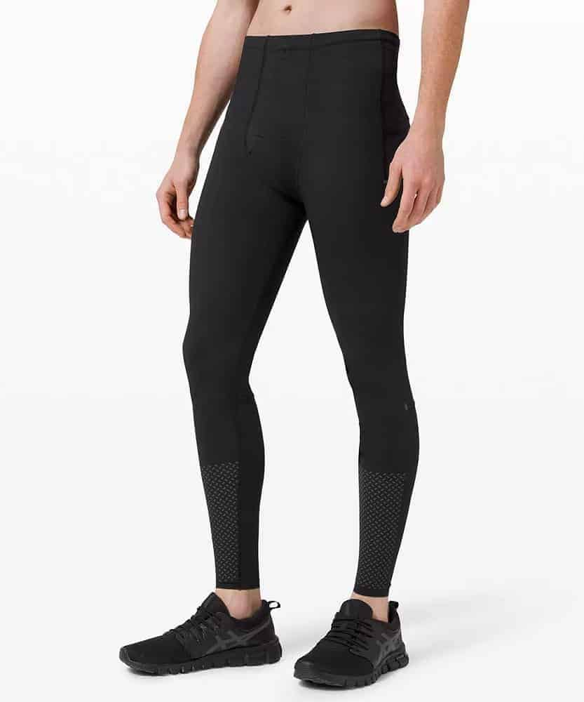 A man wearing a pair of vital drive tights from Lululemon.