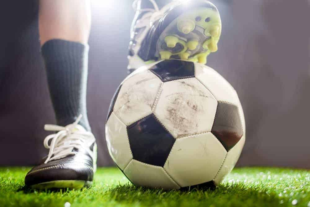 A close look at the feet of a soccer player.