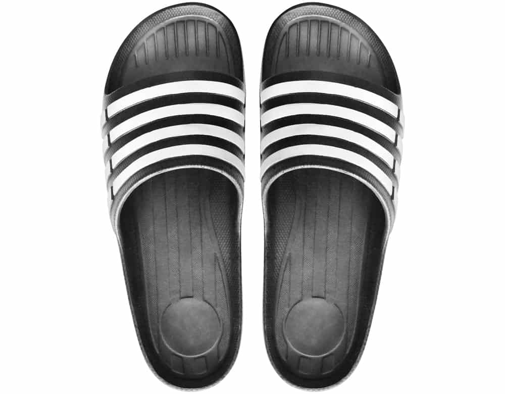 A pair of black and white rubber sandals.
