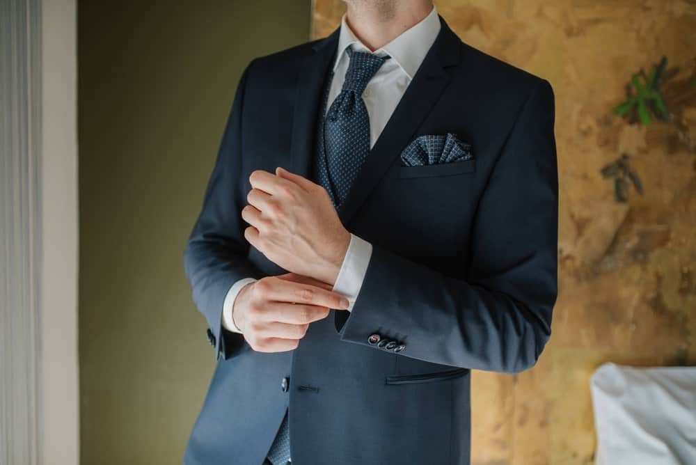 A close look at a man wearing a notch lapel suit.