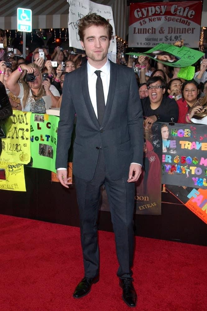 A celebrity wearing a shawl lapel black suit.