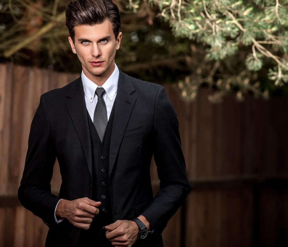 A man wearing a classic fit suit.