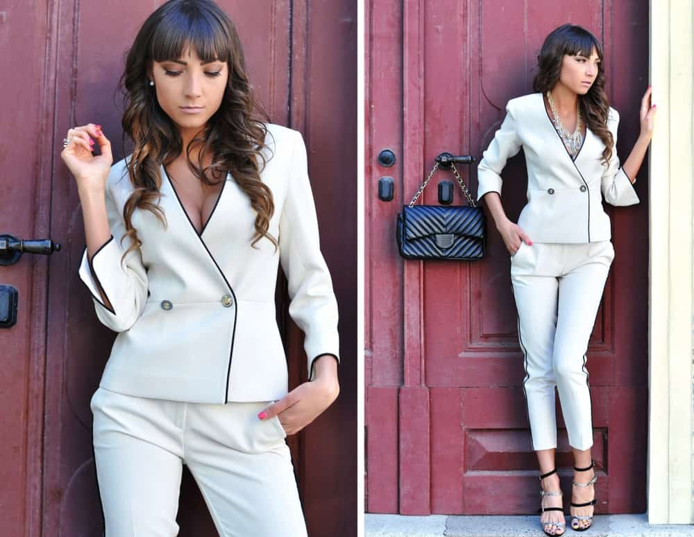 A woman wearing a slim fit suit.