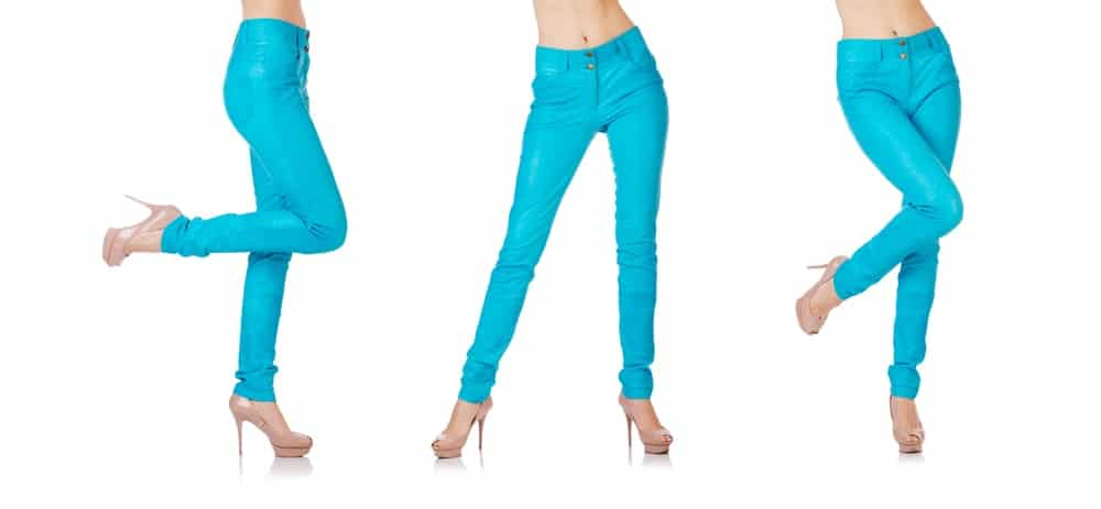 A woman modelling a pair of bright blue jeggings.