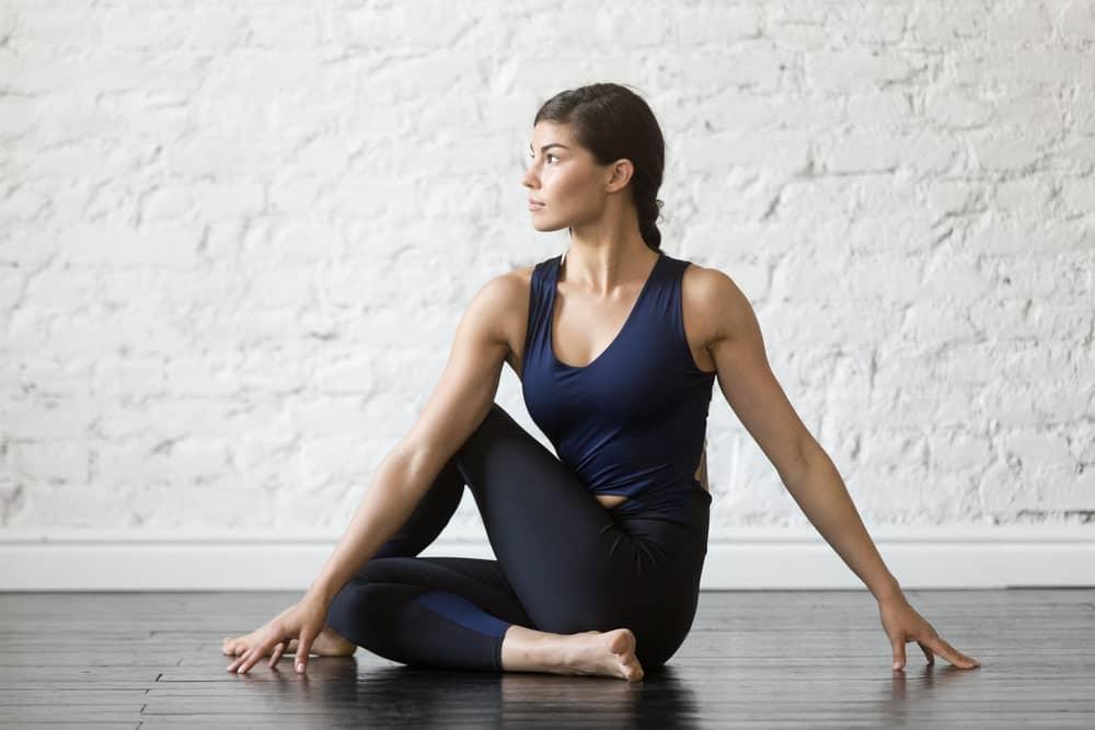 A woman wearing yoga pants at the yoga studio.