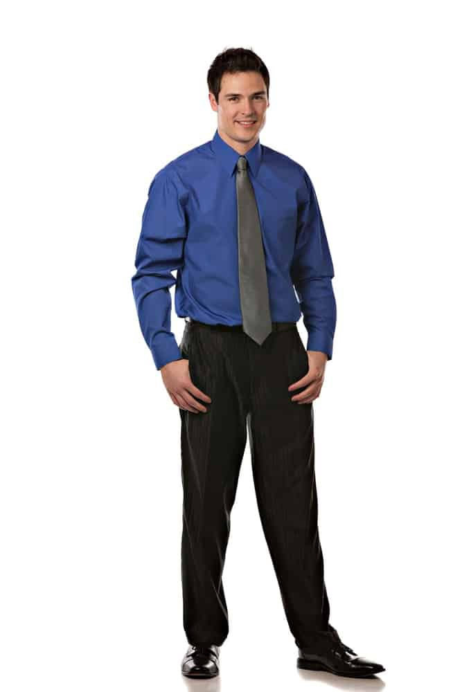 A man wearing dress pants with his office attire.