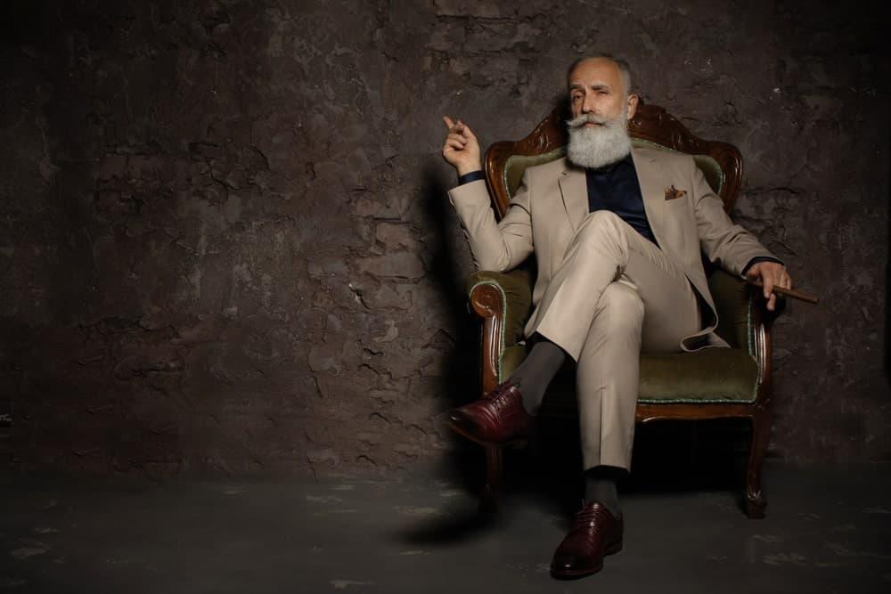 An old man wearing elegant pants.