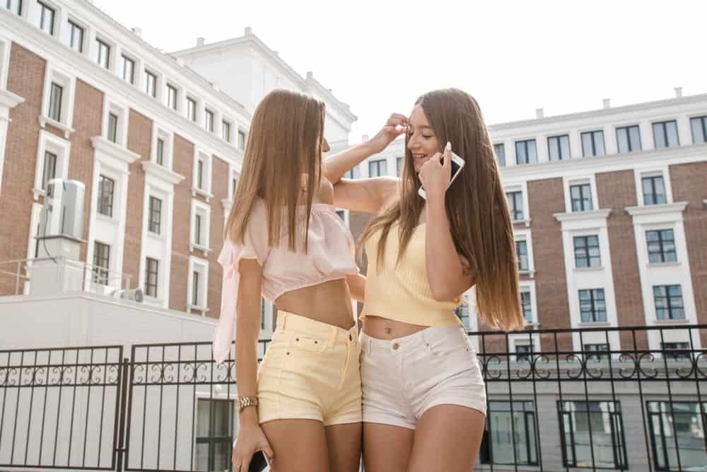 A couple of women wearing high rise shorts.