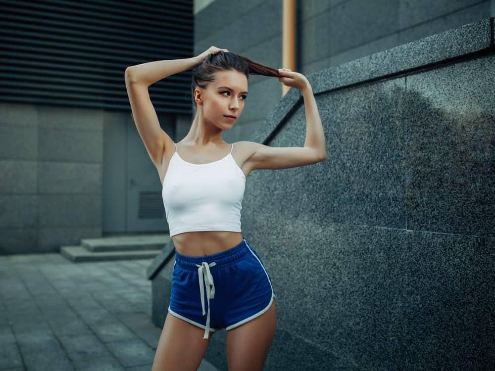 A close look at a woman wearing slim fit shorts.