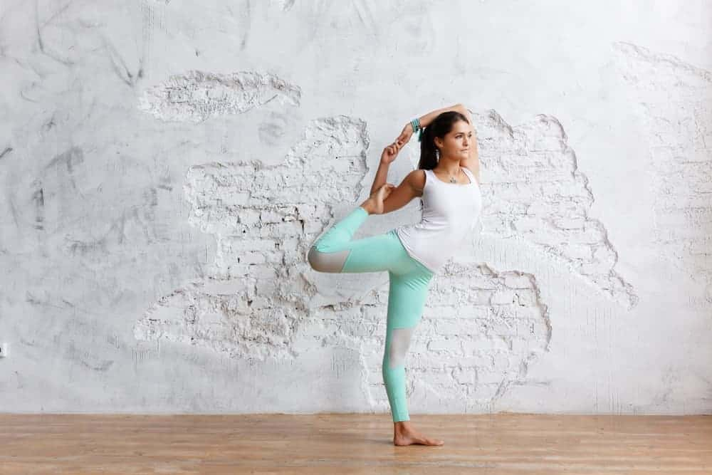 A woman with specialty yoga pants at the studio.