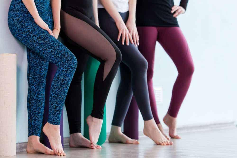 Women wearing yoga leggings at a yoga studio.