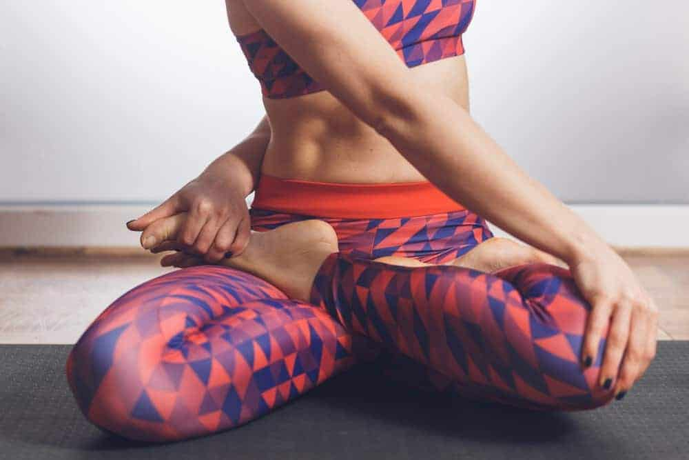 A close look at a woman wearing patterned tight yoga pants.