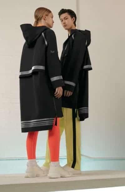 Couple wearing black Anorak jackets.