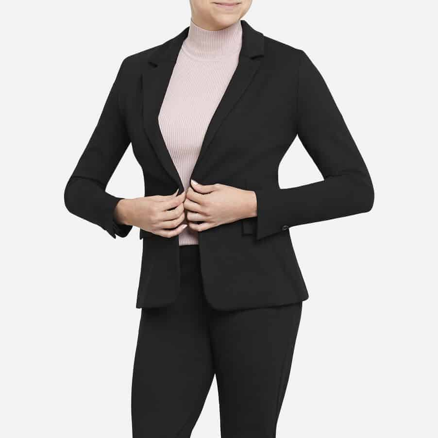 Woman wearing blazer.