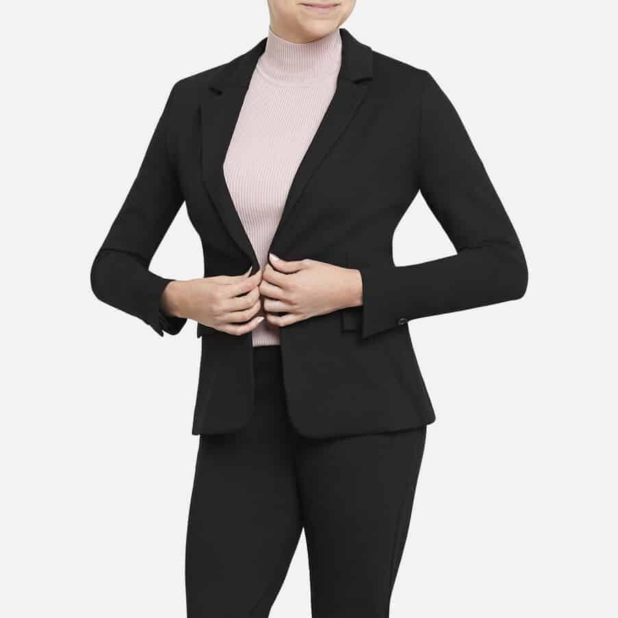 Woman wearing blazer.