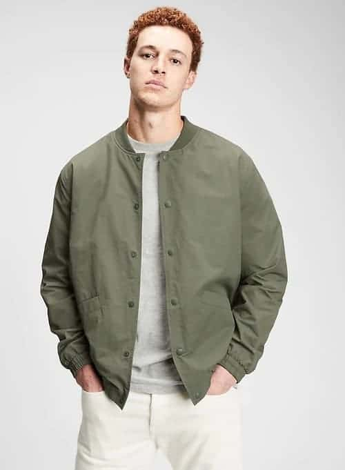 Man wearing a green bomber jacket.