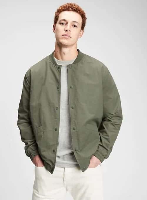 Man wearing a green bomber jacket.