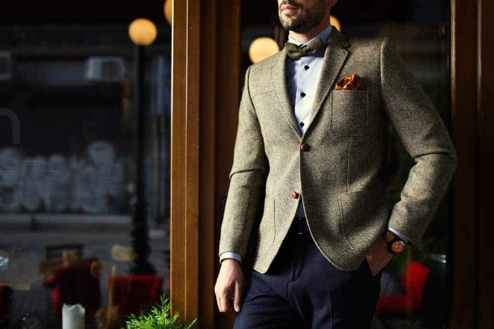 Man wearing a smart casual outfit with a bow tie.