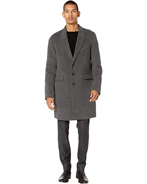 Man wearing a car coat.