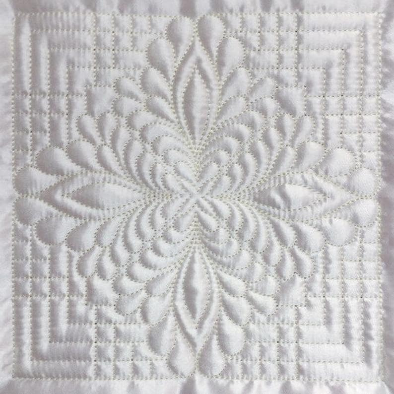 A Trapunto feather quilt from Etsy.