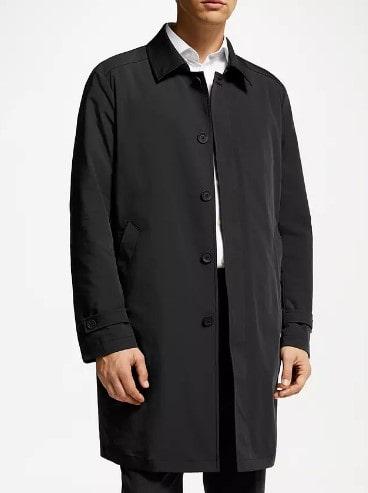 Man wearing guards coat.
