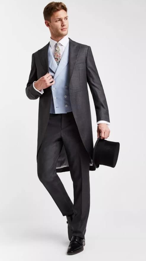 Man wearing a morning coat.
