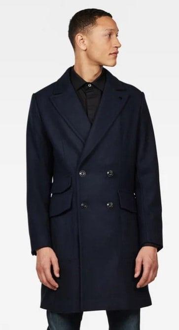 Man wearing a paletot jacket.