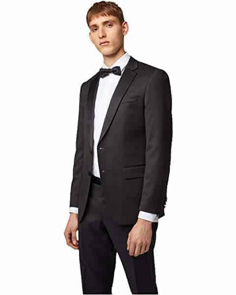 Man wearing tuxedo.