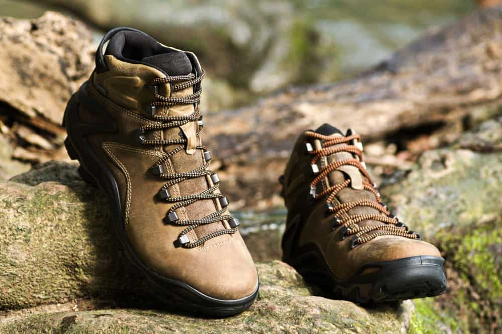 A pair of backpacking boots on a rocky terrain.