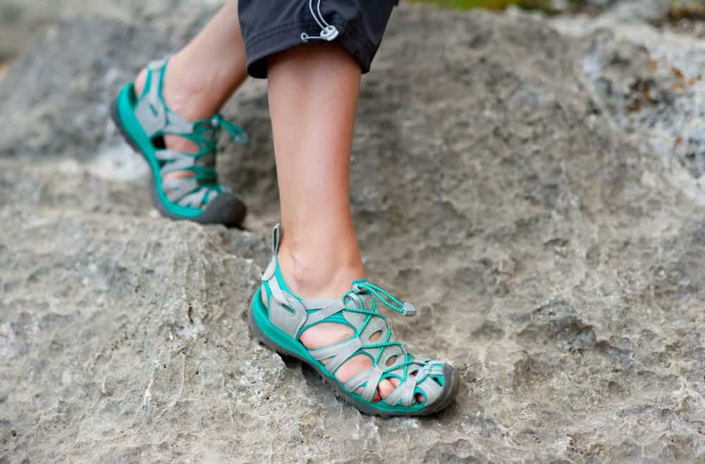 A close look at a hiker wearing a pair of hiking sandals.