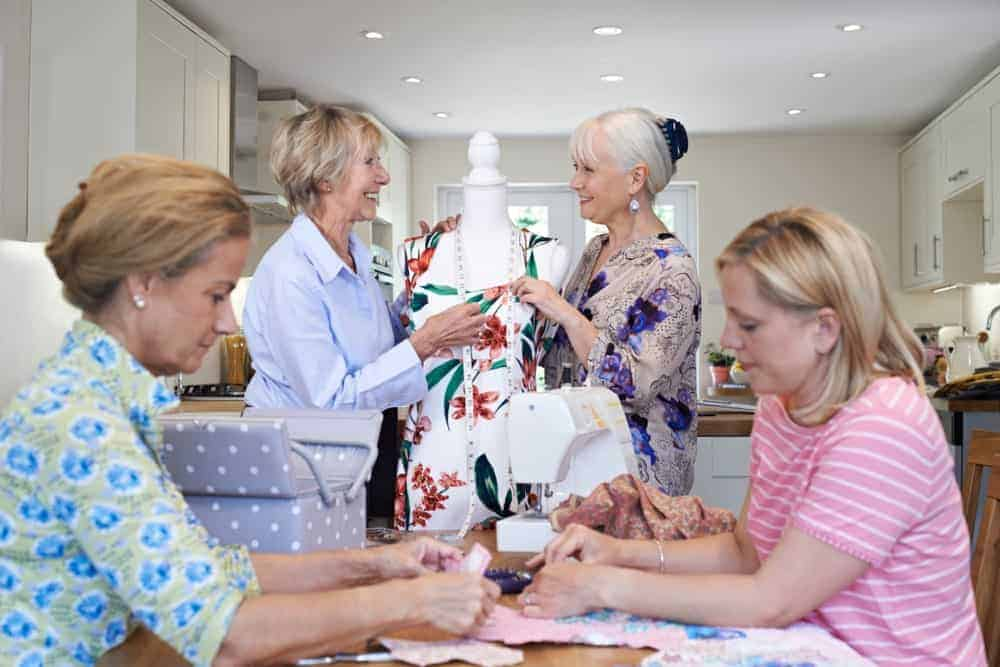 A group of women making a quilt together.