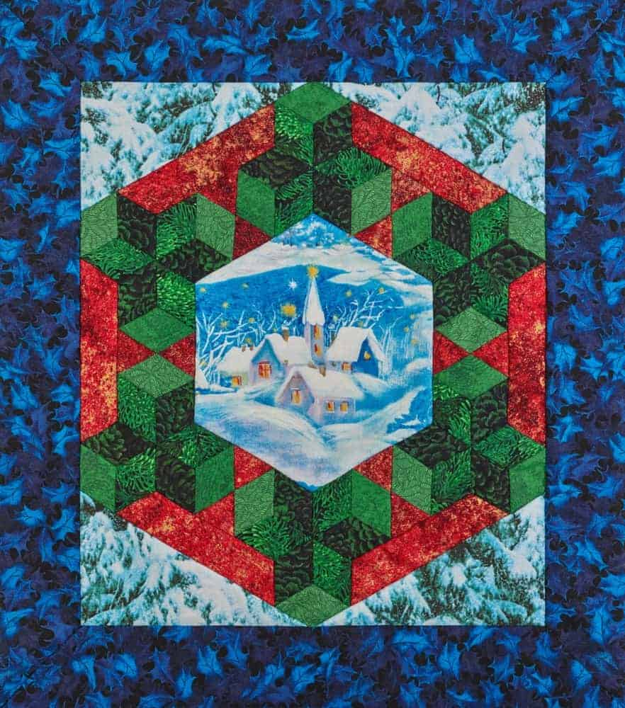 A colorful medallion quilt with a snowy landscape.