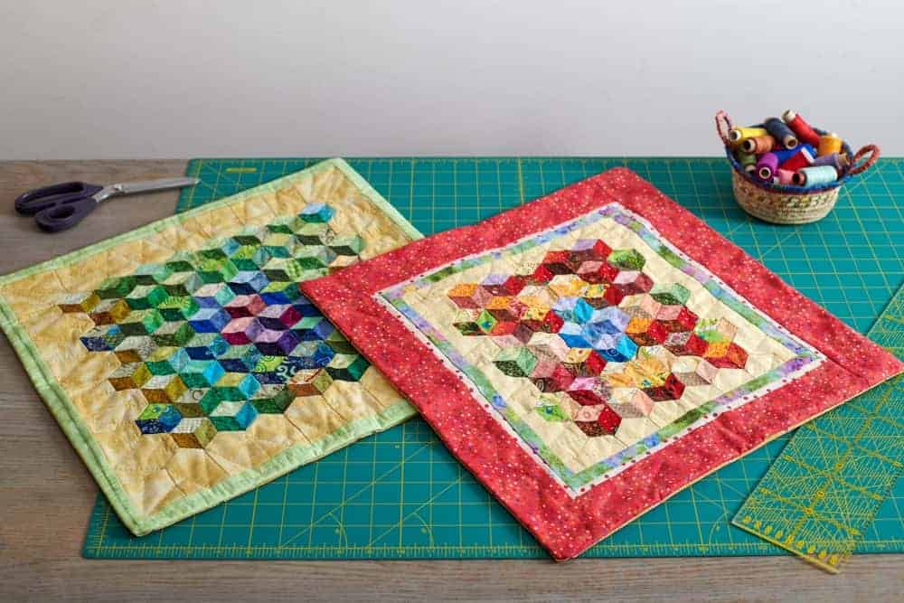 A close look at a couple of colorful miniature quilts.