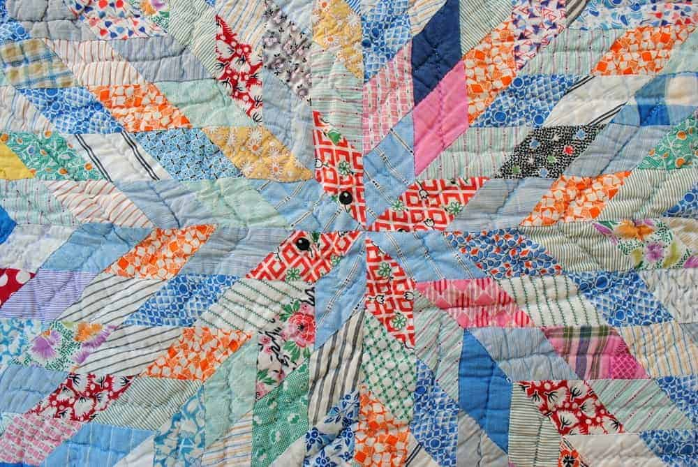 A colorful patchwork quilt with patterns.