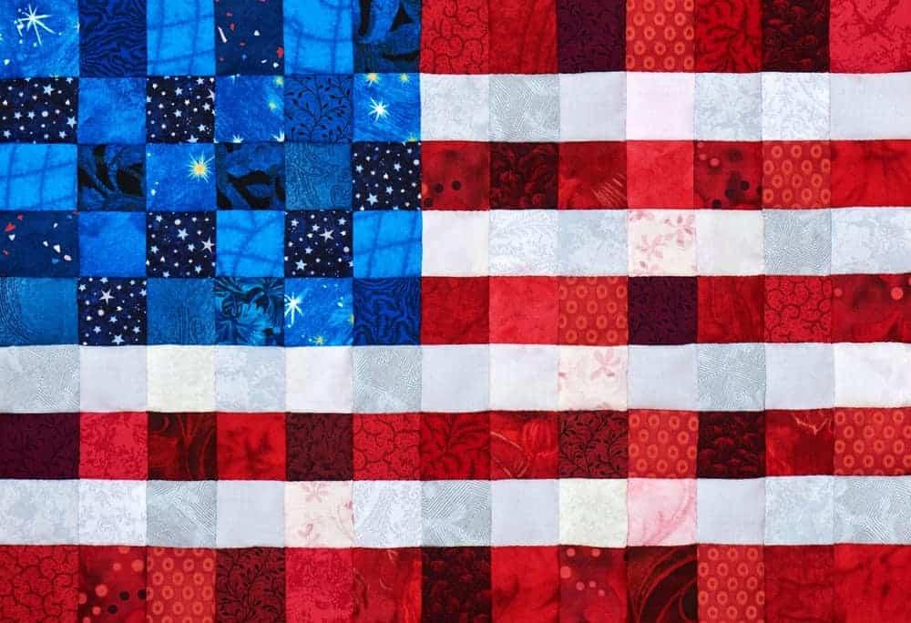 A colorful quilt in a patriotic design.