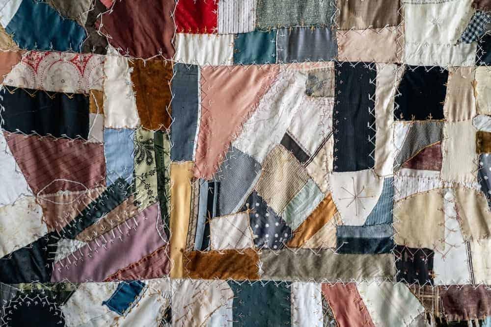 A close look at a colorful scrap quilt.