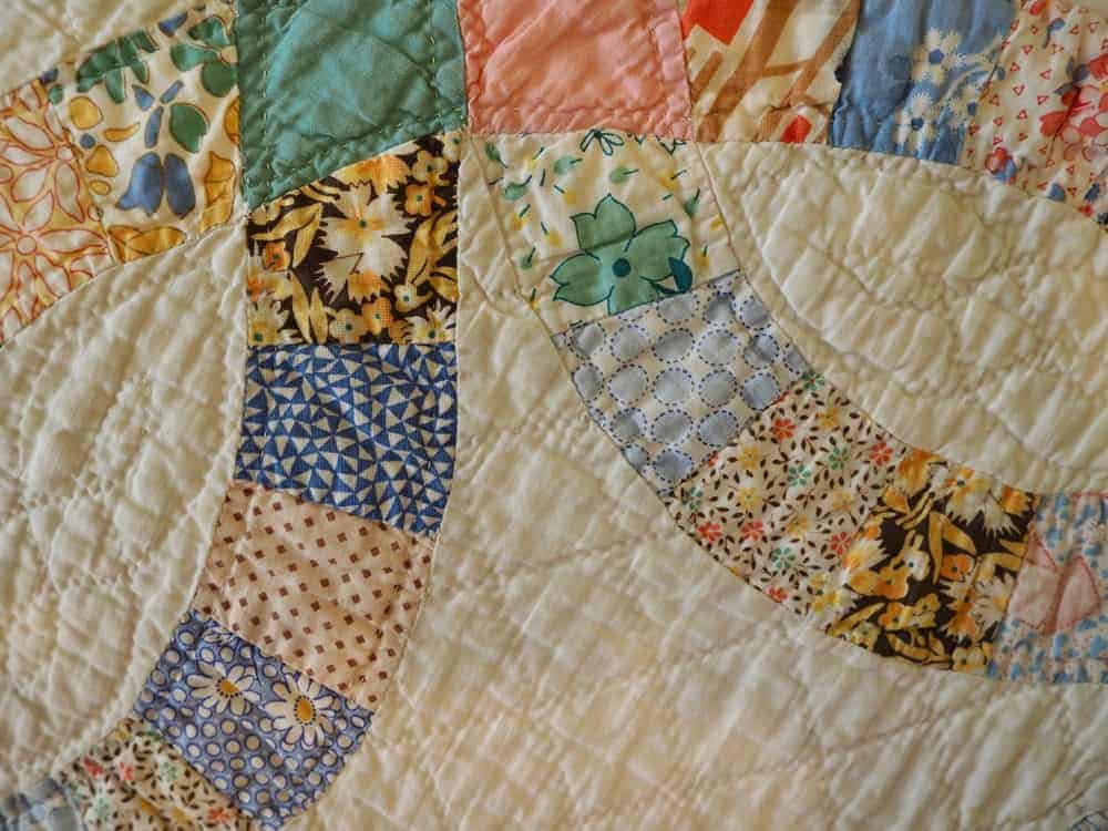 A close look at a colorful album quilt.