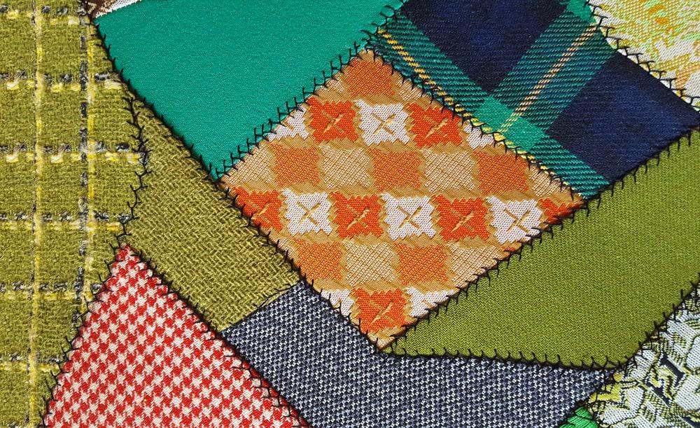 A close look at a crazy patchwork quilt.