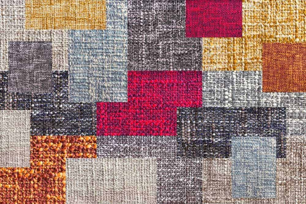 A colorful patchwork quilt with uneven pattern.
