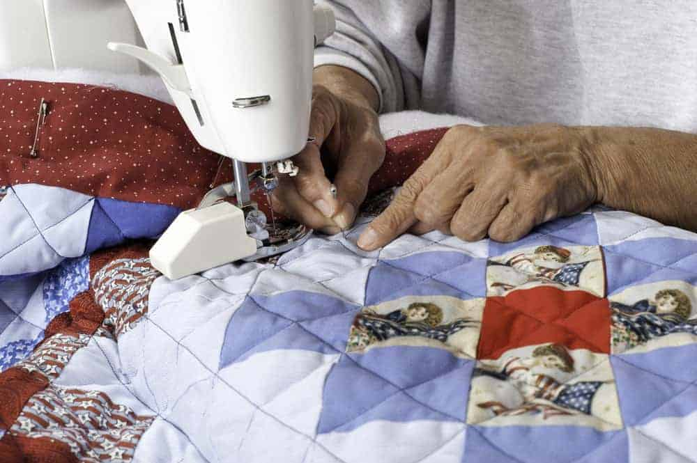 A quilt being made with a sewing machine.