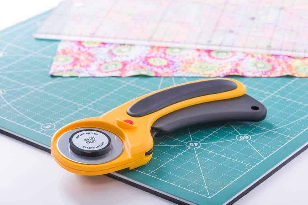A close look at a rotary cutter on a cutting pad.