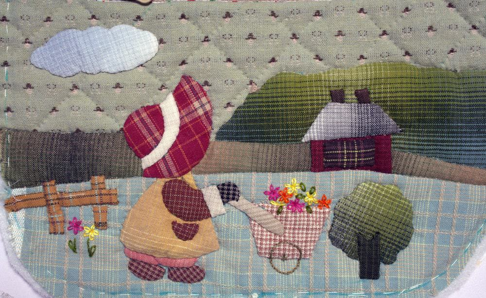A close look at a colorful applique quilt.