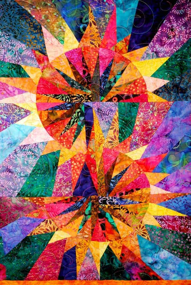 A full look at the artistic colorful quilt.