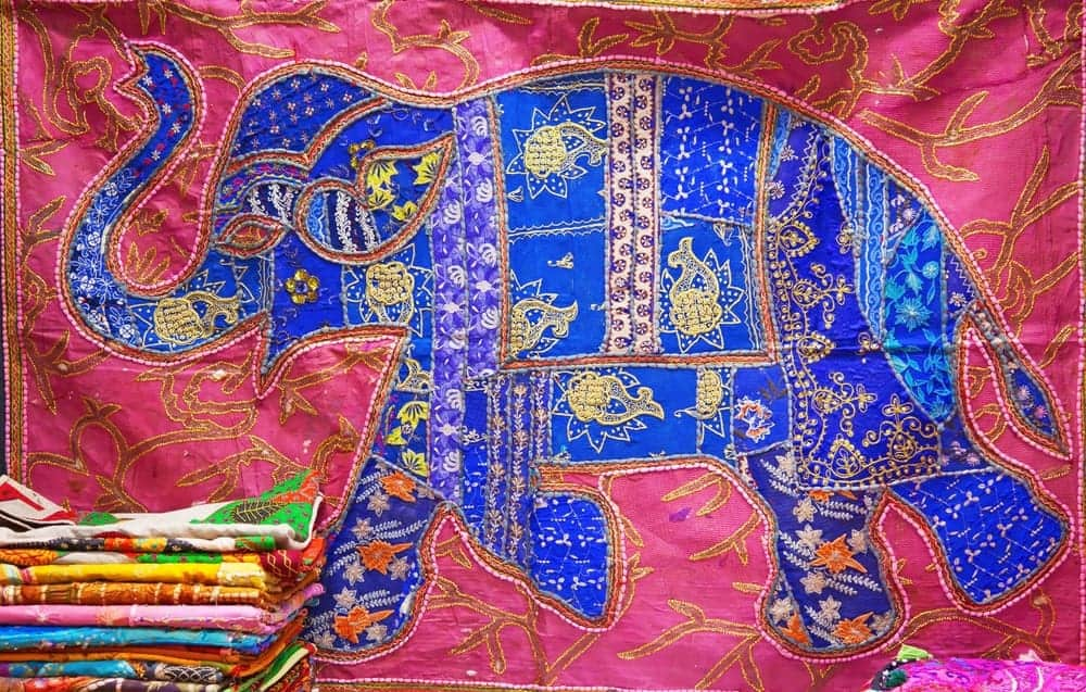A colorful crazy patch quilt.