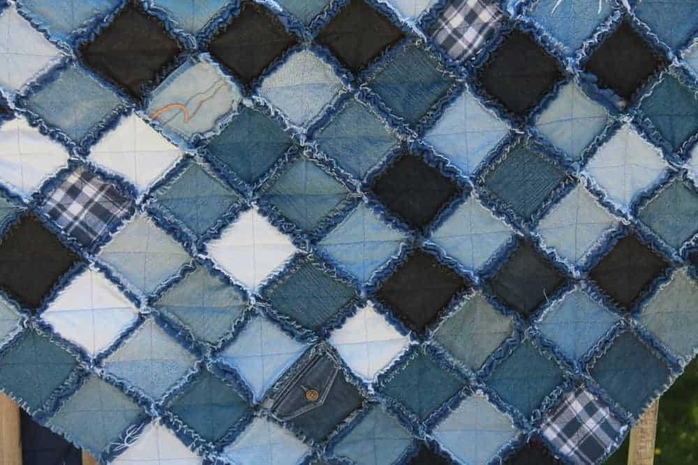 A close look at a denim quilt.