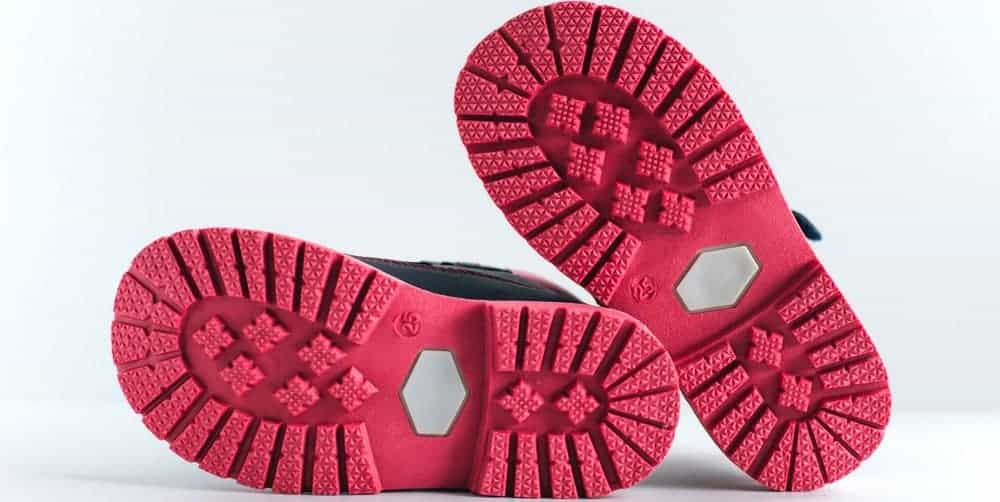 This is a close look at the sole of a pair of running shoes.