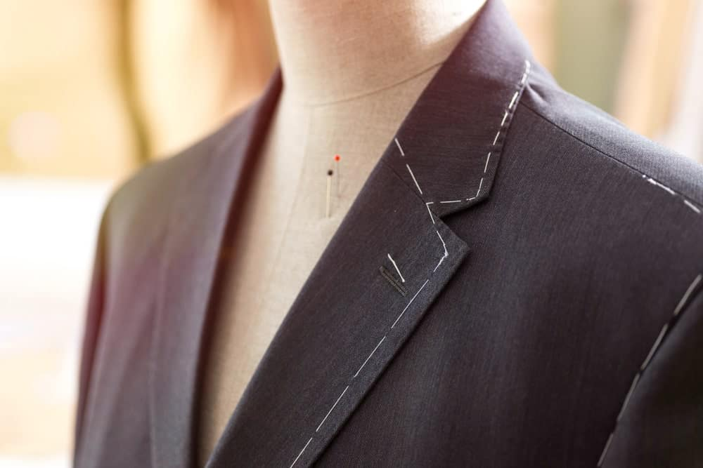 A close look at a suit with Basting/Tacking Stitch.