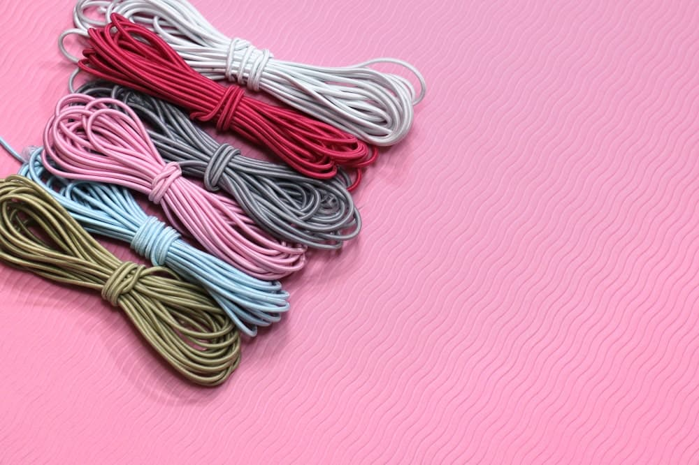 A close look at rolls of colorful elastic thread.