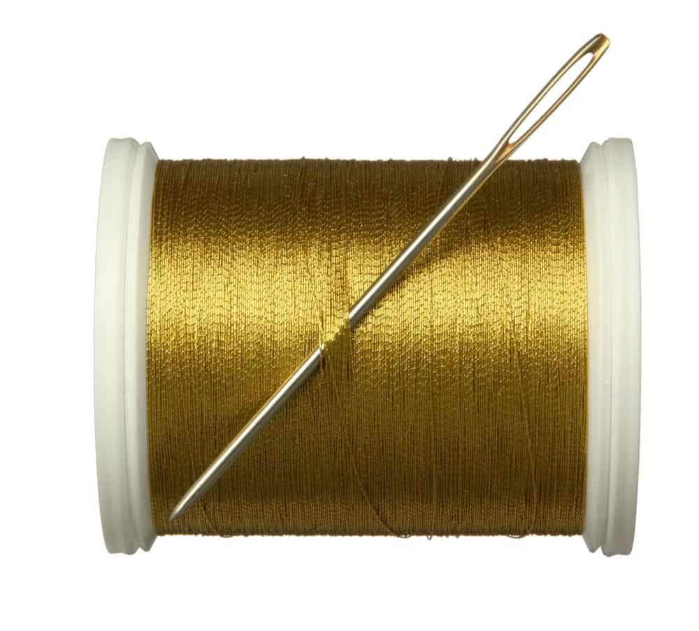 A spool of metallic thread.