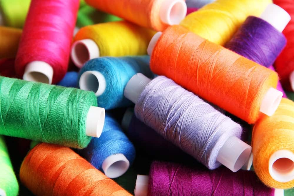 A close look at spools of colorful thread.